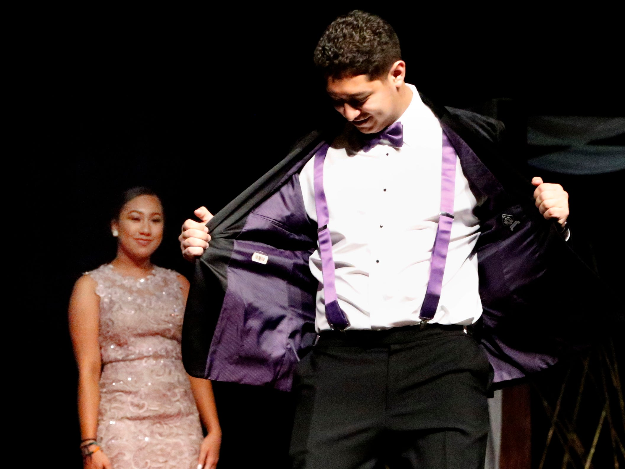 Chris Palacios shows off his tux at the end of the runway during the Siegel Prom Fashion show on Thursday, Feb. 14, 2019.
