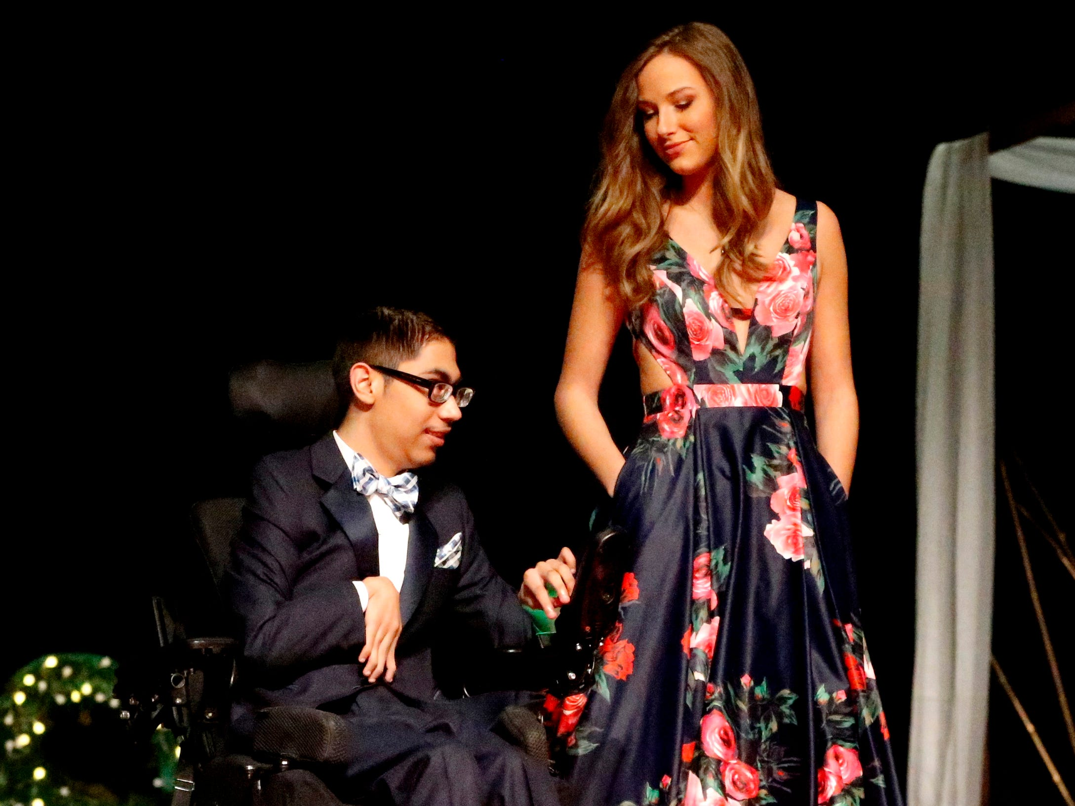Jason Guerro, left and Ellie Hooper right show off the latest in prom fashions during the Siegel Prom Fashion show on Thursday, Feb. 14, 2019.