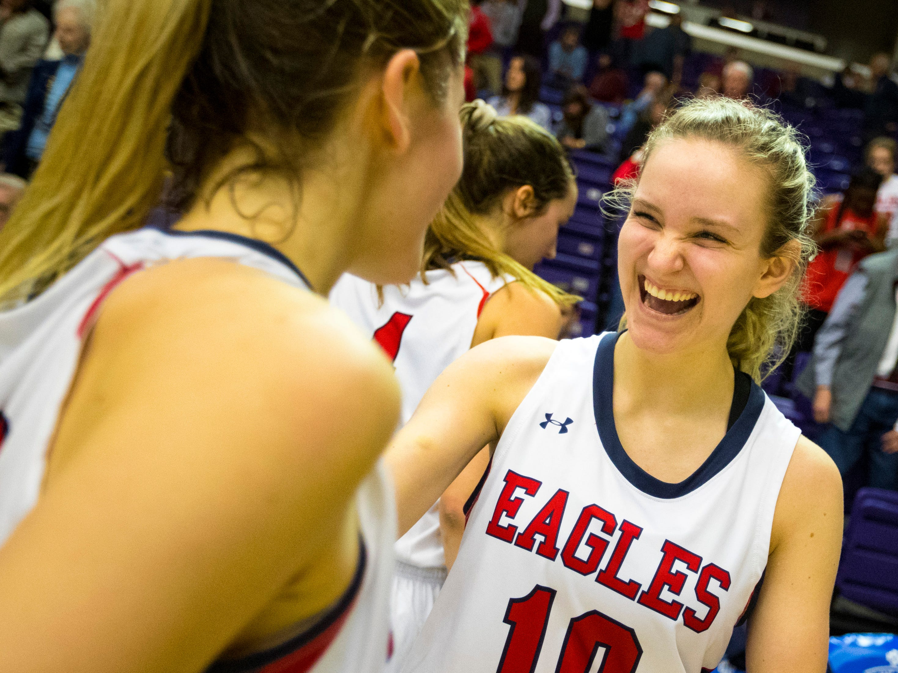 Brentwood Academy's Blair Schoenwald (10) celebrates with Brentwood Academy's Avery Kovick (22) after Brentwood Academy's game against Father Ryan in the semifinal round of the TSSAA Division II Class AA State Championships at Lipscomb University's Allen Arena in Nashville on Thursday, Feb. 28, 2019.
