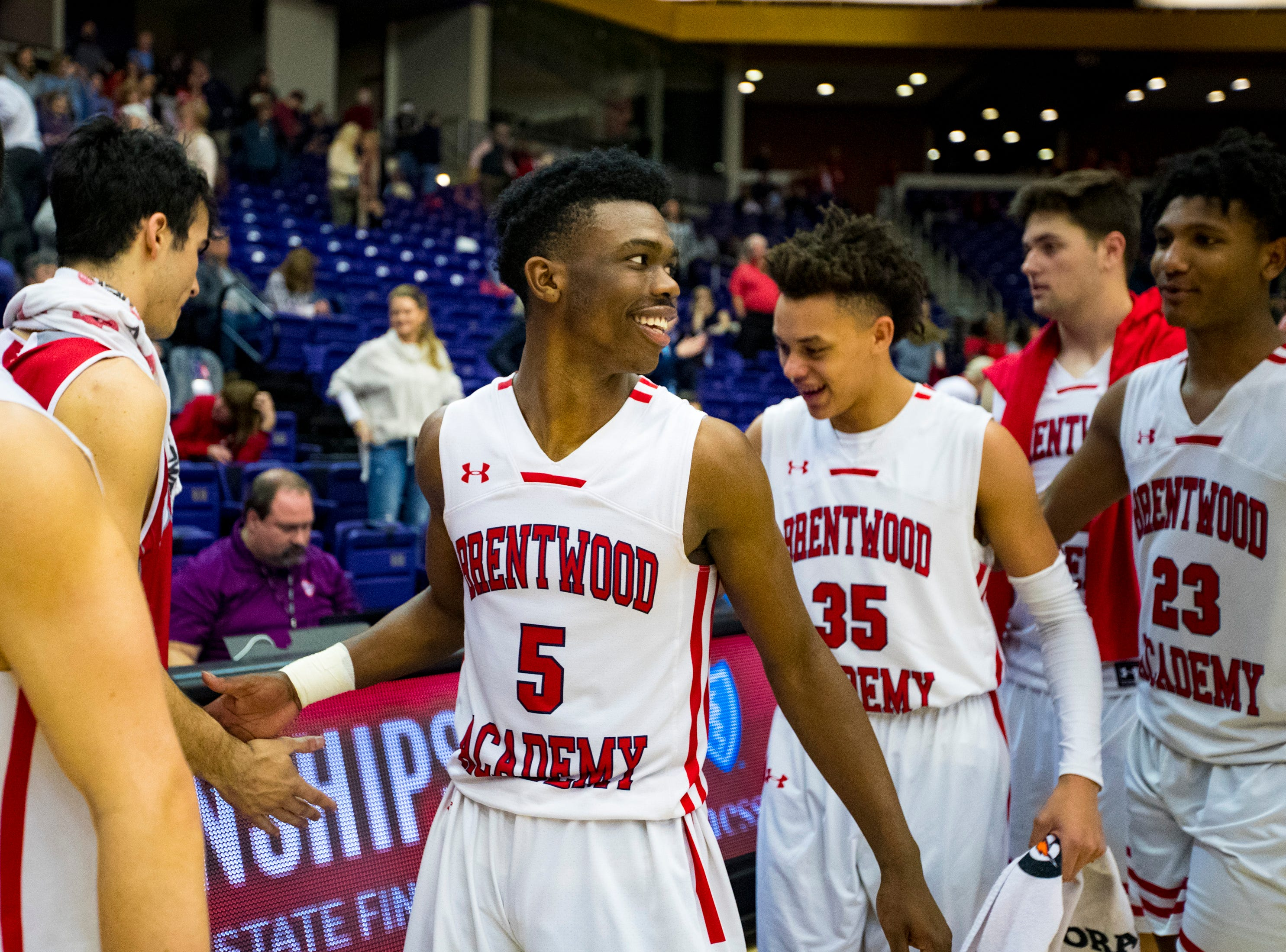 Brentwood Academy's Marcus Fitzgerald (5) smiles while shaking hands after Brentwood Academy's game against Baylor in the semifinal round of the TSSAA Division II Class AA State Championships at Lipscomb University's Allen Arena in Nashville on Thursday, Feb. 28, 2019.