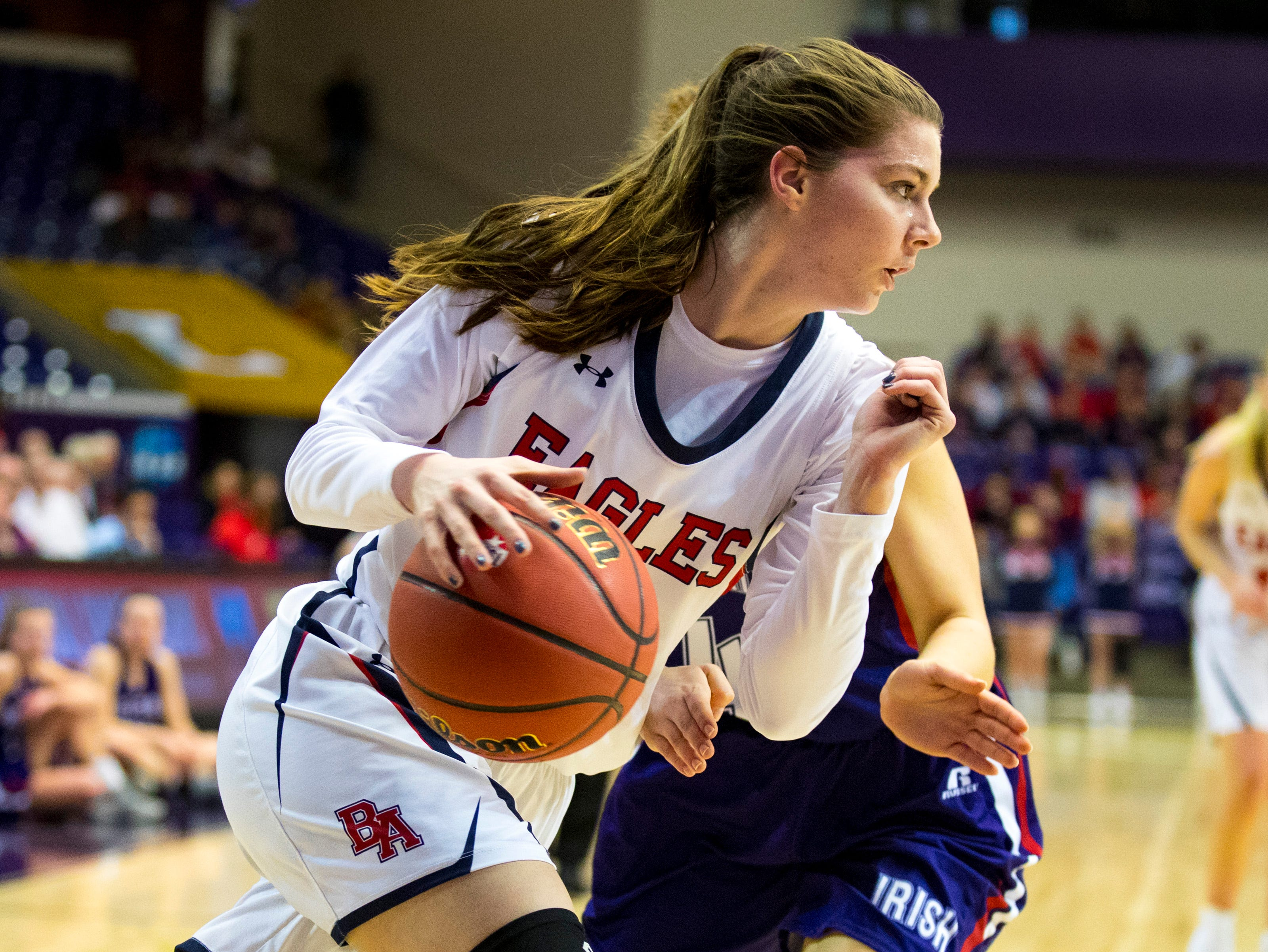 Brentwood Academy's Lauren Graham (12) drives towards the basket during Brentwood Academy's game against Father Ryan in the semifinal round of the TSSAA Division II Class AA State Championships at Lipscomb University's Allen Arena in Nashville on Thursday, Feb. 28, 2019.