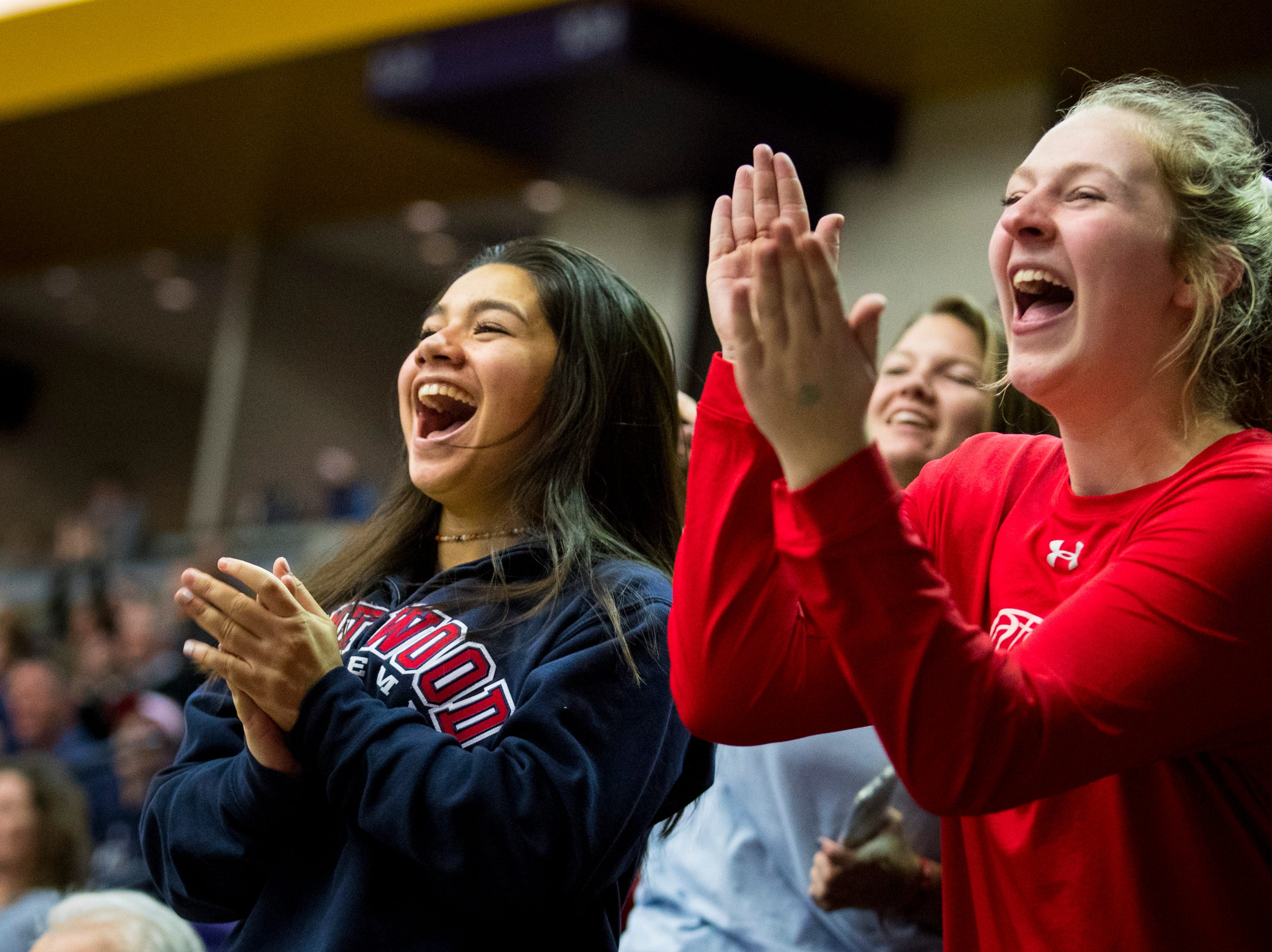 Brentwood Academy students Teya Tagatauli, left, and Annabelle Dreher cheer during Brentwood Academy's game against Father Ryan in the semifinal round of the TSSAA Division II Class AA State Championships at Lipscomb University's Allen Arena in Nashville on Thursday, Feb. 28, 2019.