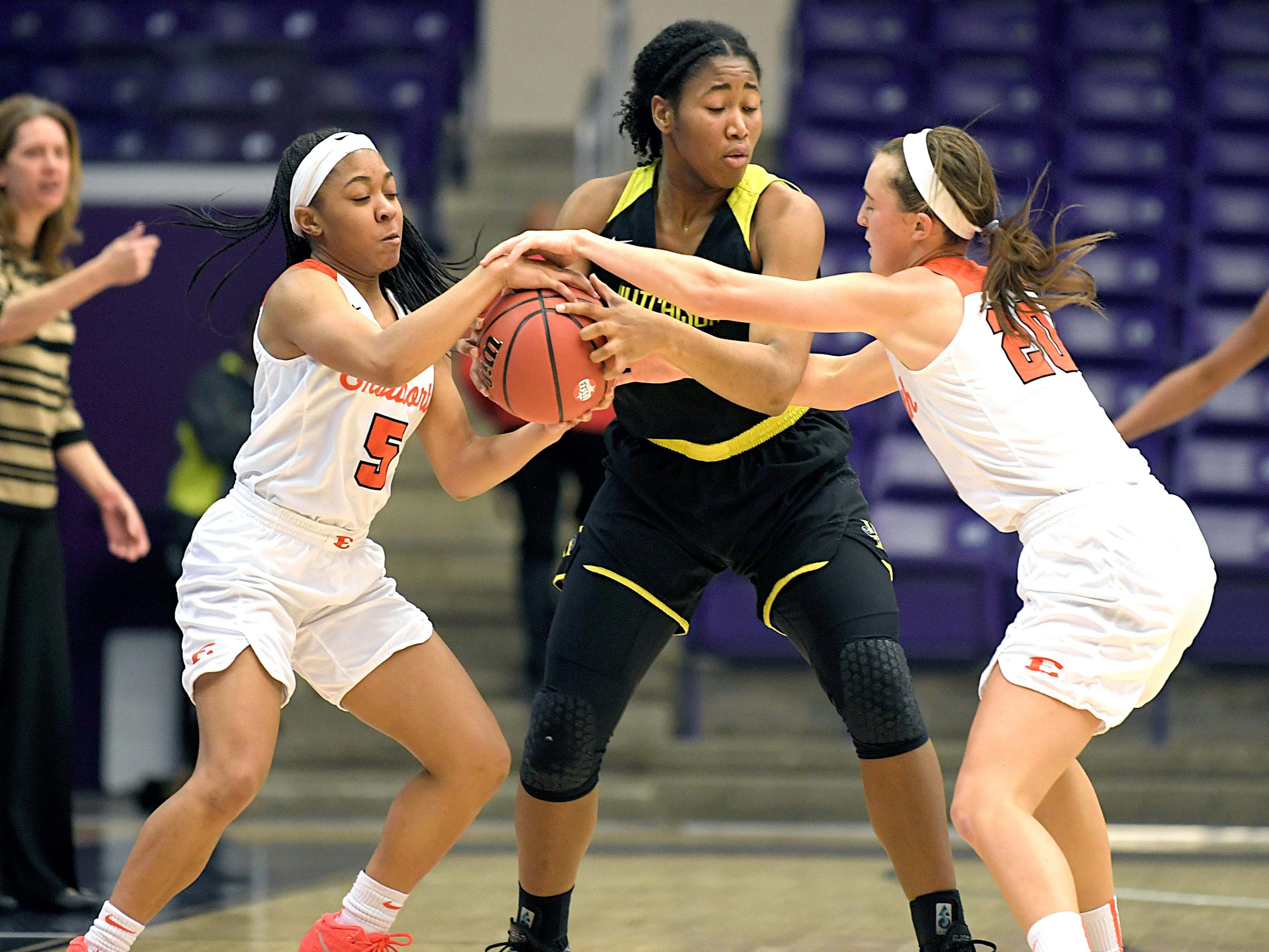 Ensworth's Jayda Woods (5) and Annabel Frist (20) take the ball away from Hutchison;s Carmyn Harrison (33)   during the TSSAA Division II Class AA semifinals at Lipscomb University's Allen Arena in Nashville on Thursday, Feb. 28, 2019.