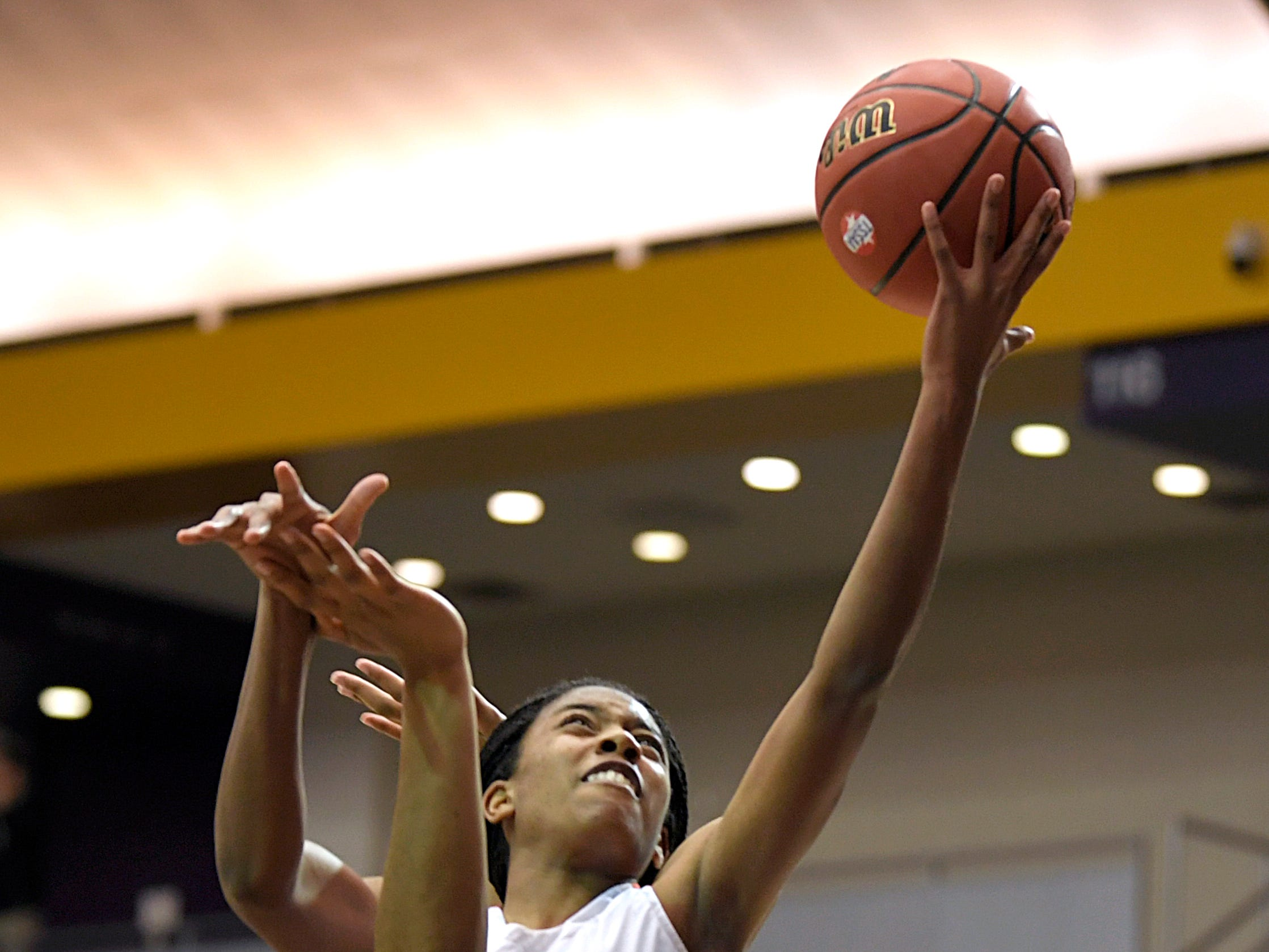 Ensworth's Kaiya Wynn (21) shoots against a Hutchison player during the TSSAA Division II Class AA semifinals at Lipscomb University's Allen Arena in Nashville on Thursday, Feb. 28, 2019.
