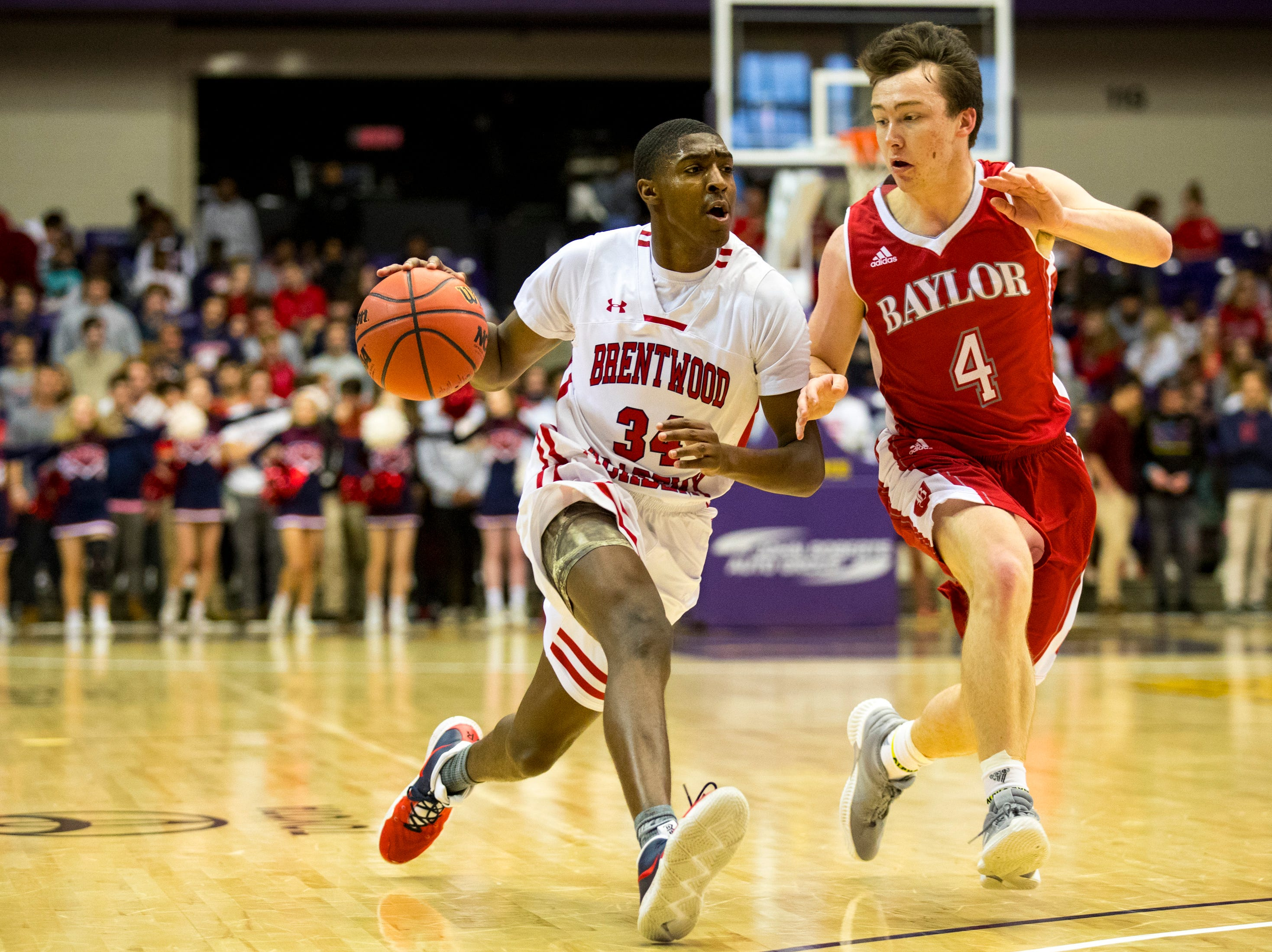 Brentwood Academy's Randy Brady (34) tries to get around Baylor's Blake Pruitt (4) during Brentwood Academy's game against Baylor in the semifinal round of the TSSAA Division II Class AA State Championships at Lipscomb University's Allen Arena in Nashville on Thursday, Feb. 28, 2019.
