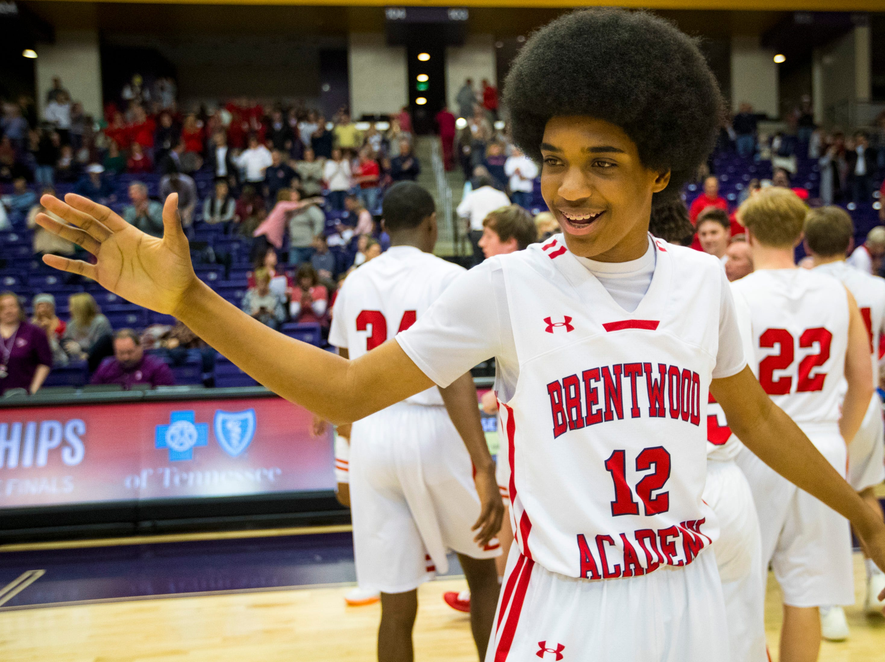 Brentwood Academy's Trent McNair (12) celebrates after Brentwood Academy's game against Baylor in the semifinal round of the TSSAA Division II Class AA State Championships at Lipscomb University's Allen Arena in Nashville on Thursday, Feb. 28, 2019.