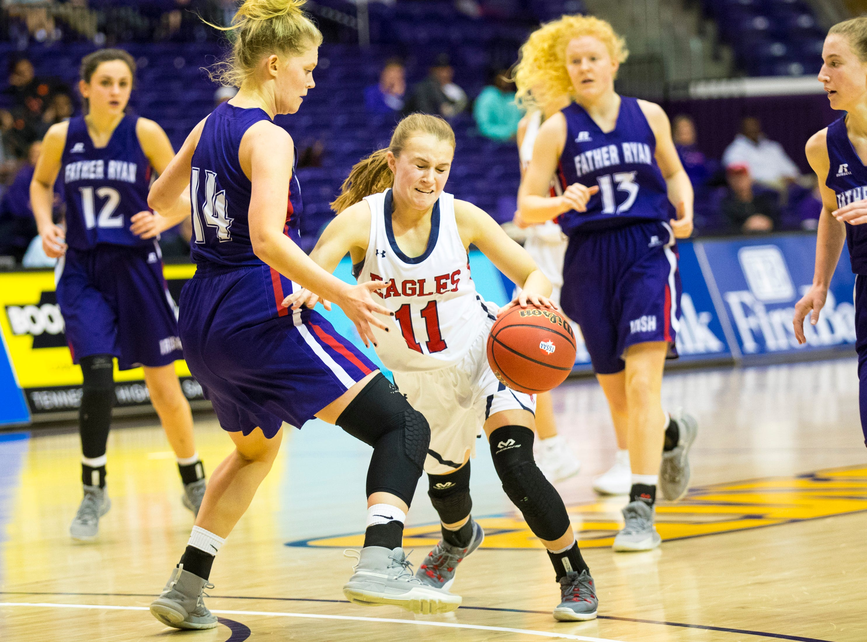 Brentwood Academy's Millie Brown (11) makes contact with Father Ryan's Bree Thibeault (14) during Brentwood Academy's game against Father Ryan in the semifinal round of the TSSAA Division II Class AA State Championships at Lipscomb University's Allen Arena in Nashville on Thursday, Feb. 28, 2019.