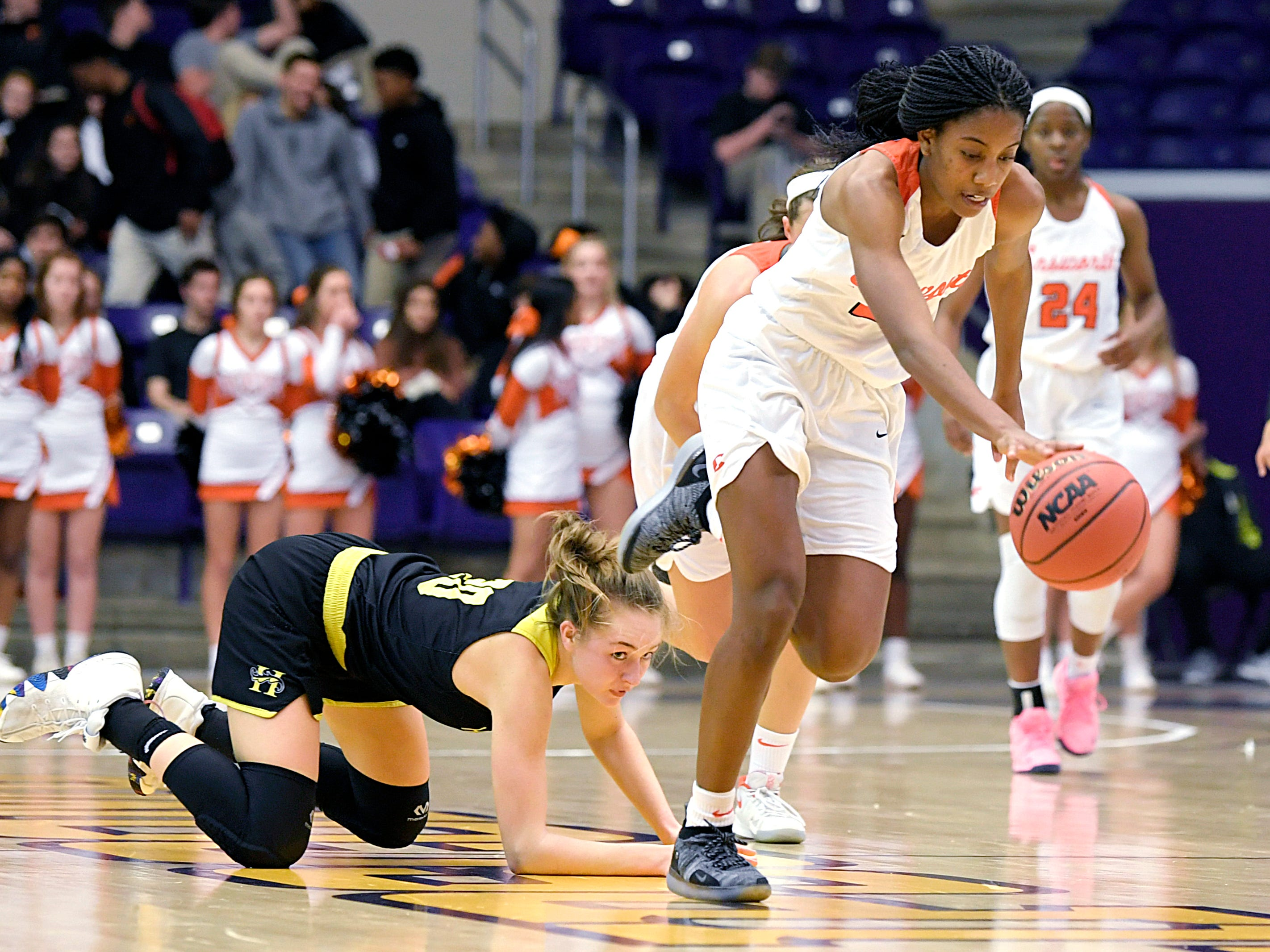 Ensworth's Kaiya Wynn (21) steals the ball from Hutchison's Maxine Engle (20) during the TSSAA Division II Class AA semifinals at Lipscomb University's Allen Arena in Nashville on Thursday, Feb. 28, 2019.