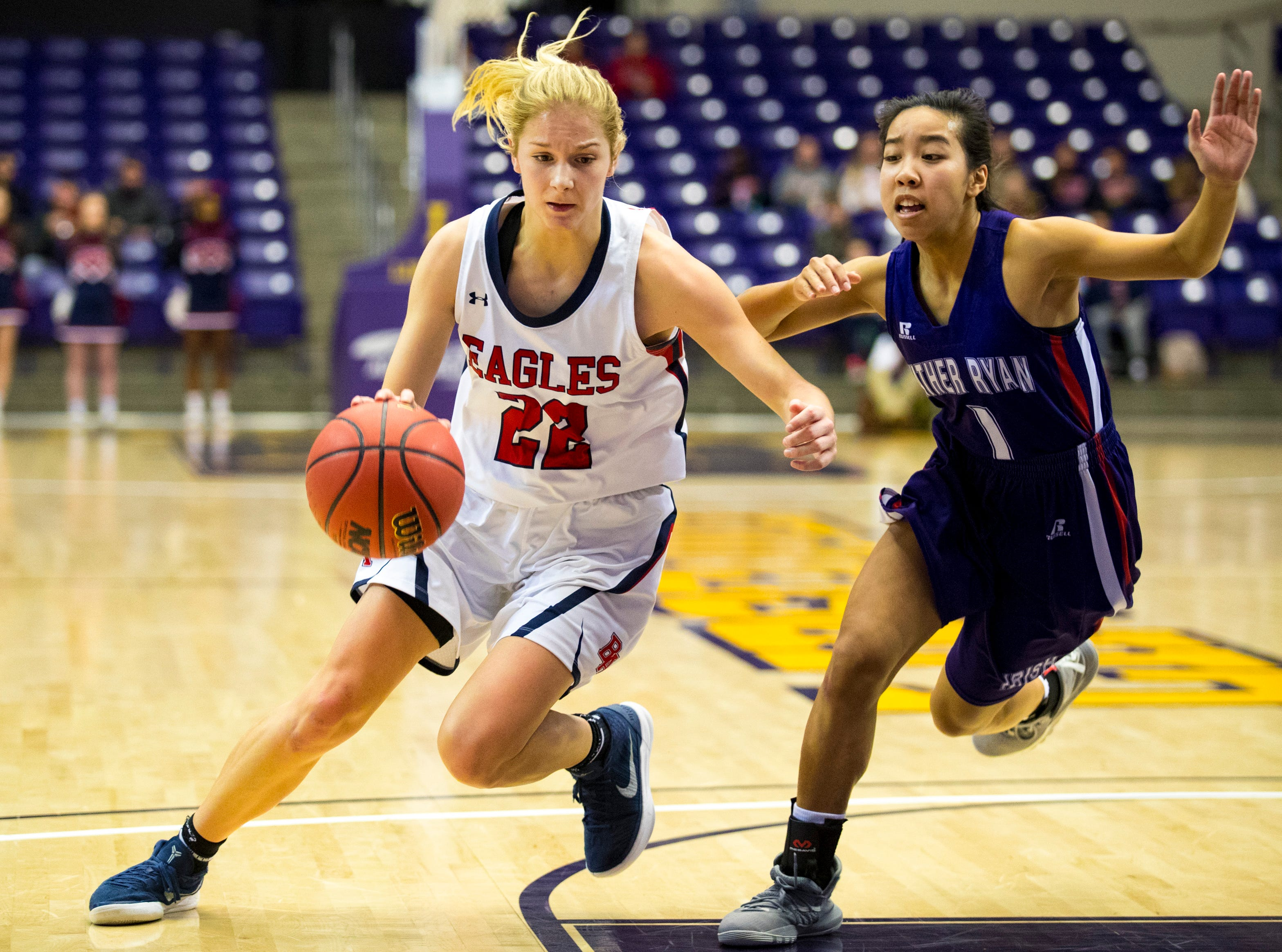 Brentwood Academy's Avery Kovick (22) drives around Father Ryan's Christine Quitalig (1) during Brentwood Academy's game against Father Ryan in the semifinal round of the TSSAA Division II Class AA State Championships at Lipscomb University's Allen Arena in Nashville on Thursday, Feb. 28, 2019.