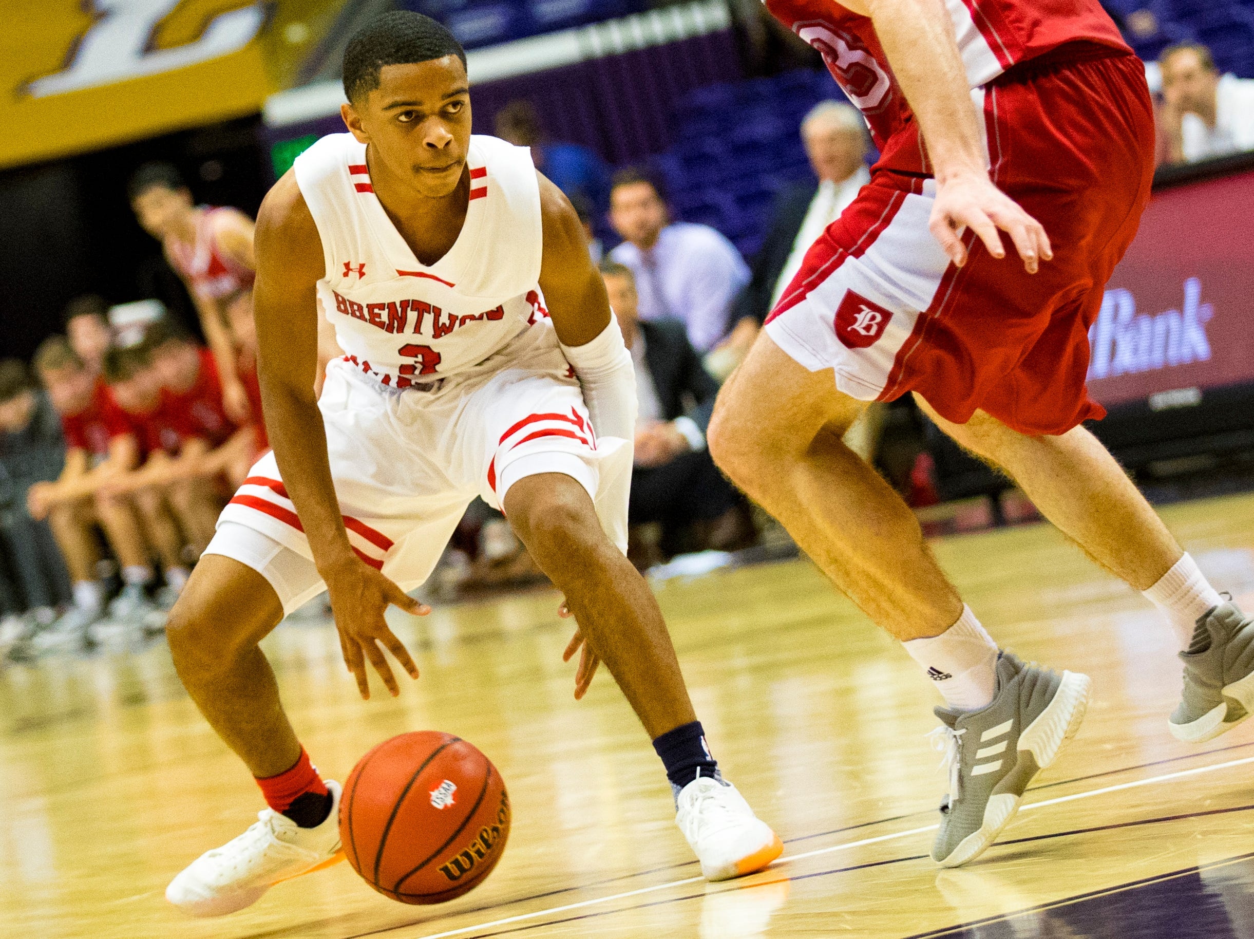 Brentwood Academy's BJ Davis (3) dribbles through his legs during Brentwood Academy's game against Baylor in the semifinal round of the TSSAA Division II Class AA State Championships at Lipscomb University's Allen Arena in Nashville on Thursday, Feb. 28, 2019.