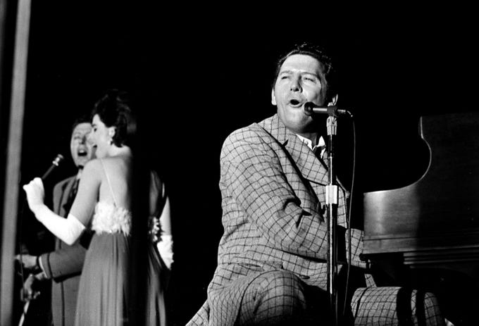 Jerry Lee Lewis, right, is performing for the crowd of 950 during the NARAS annual gala awards celebration for the Grammy at the National Guard Armory on March 12, 1969.