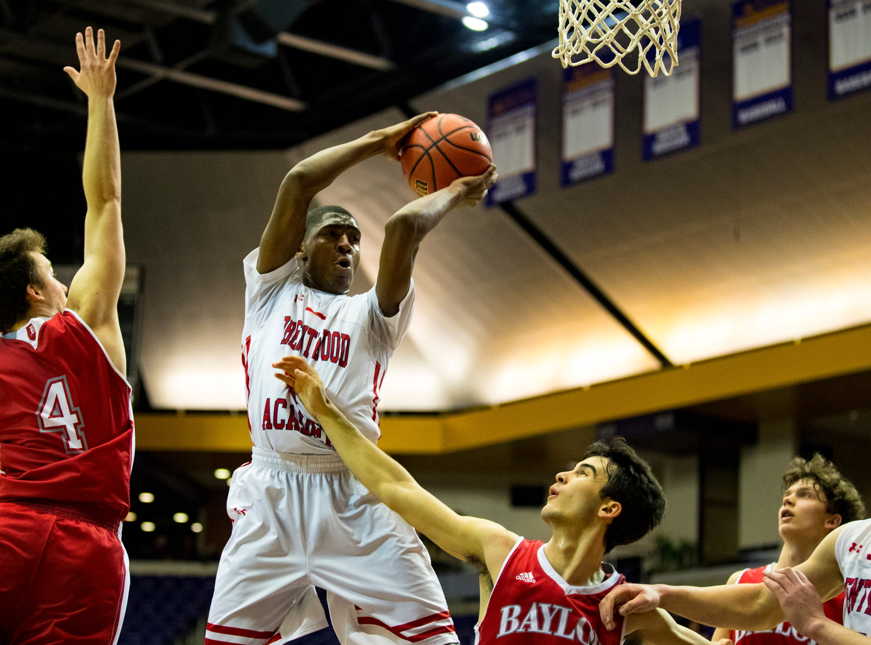 Brentwood Academy's Randy Brady (34) grabs a rebound during Brentwood Academy's game against Baylor in the semifinal round of the TSSAA Division II Class AA State Championships at Lipscomb University's Allen Arena in Nashville on Thursday, Feb. 28, 2019.