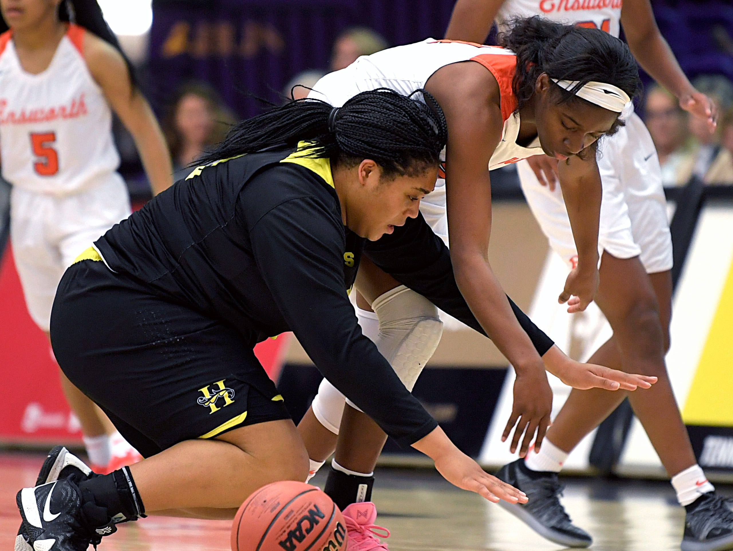 Hutchison's Kaia Barnett (32) and Ensworth's Dontavia Waggoner (24) fight for a loose ball during the TSSAA Division II Class AA semifinals at Lipscomb University's Allen Arena in Nashville on Thursday, Feb. 28, 2019.
