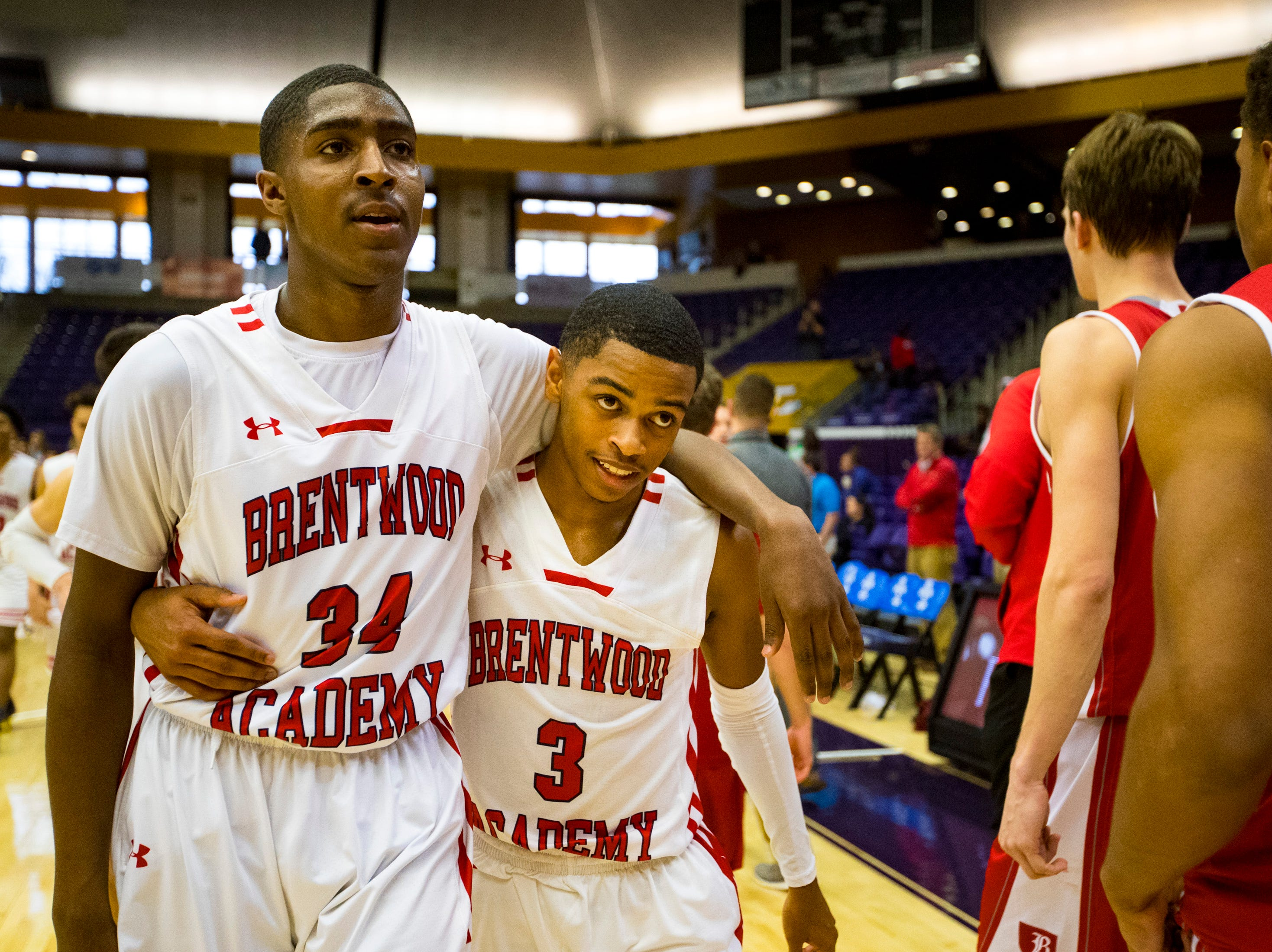 Brentwood Academy's Randy Brady (34) and Brentwood Academy's BJ Davis (3) walk arm in arm after Brentwood Academy's game against Baylor in the semifinal round of the TSSAA Division II Class AA State Championships at Lipscomb University's Allen Arena in Nashville on Thursday, Feb. 28, 2019.