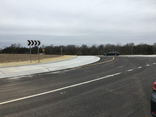 A car enters the roundabout portion of an extension on Legends Drive now open to traffic. The city invested $5.8 million into the extension with hopes it can draw development.