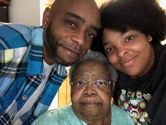 LongHorn Steakouse grill chef Choya Phillips, left, with his mother, Annetta, and his older daughter, Breanne, shortly before his mother died