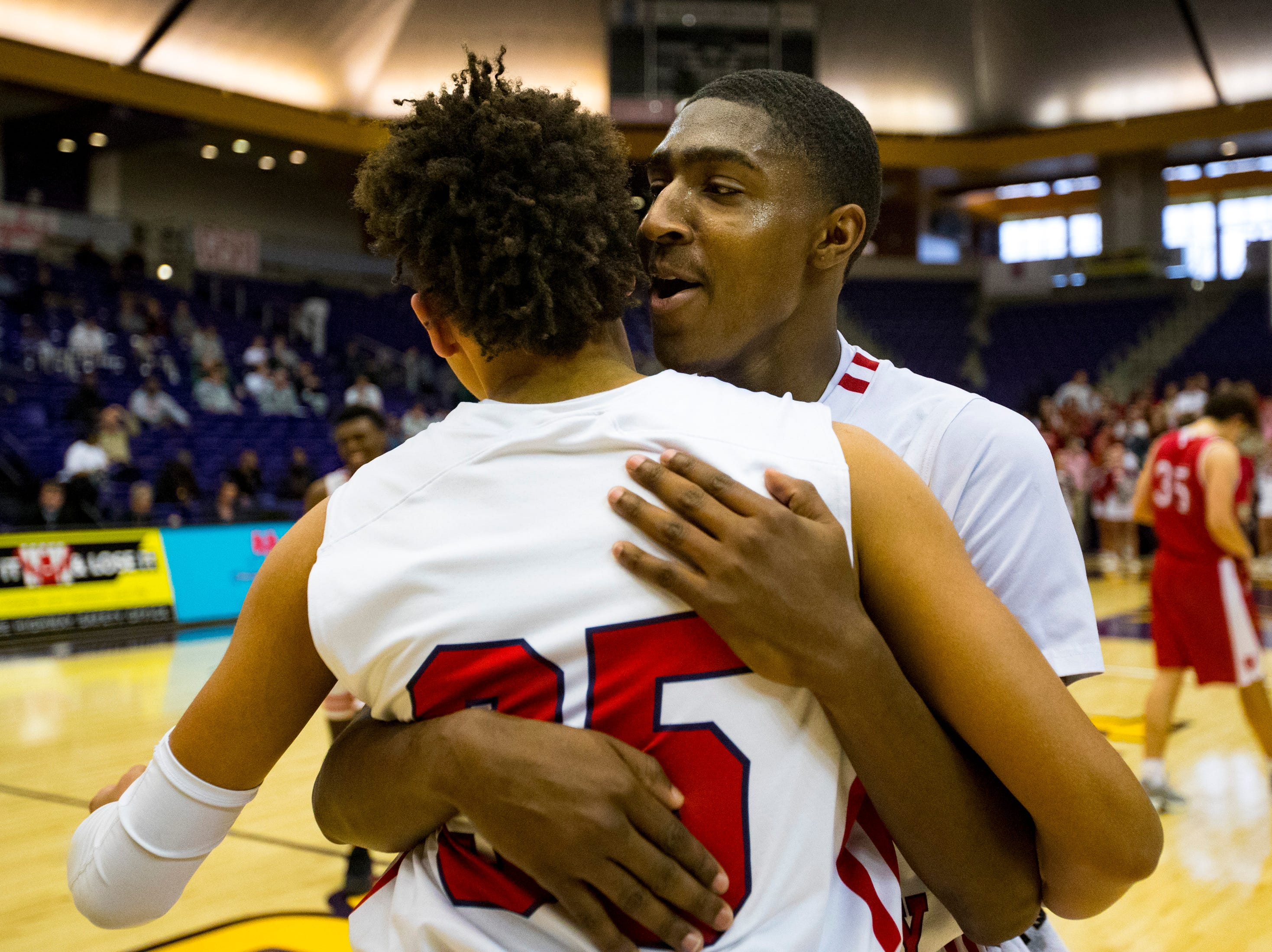 Brentwood Academy's Randy Brady (34) hugs Brentwood Academy's DJ Senter (35) after Brentwood Academy's game against Baylor in the semifinal round of the TSSAA Division II Class AA State Championships at Lipscomb University's Allen Arena in Nashville on Thursday, Feb. 28, 2019.