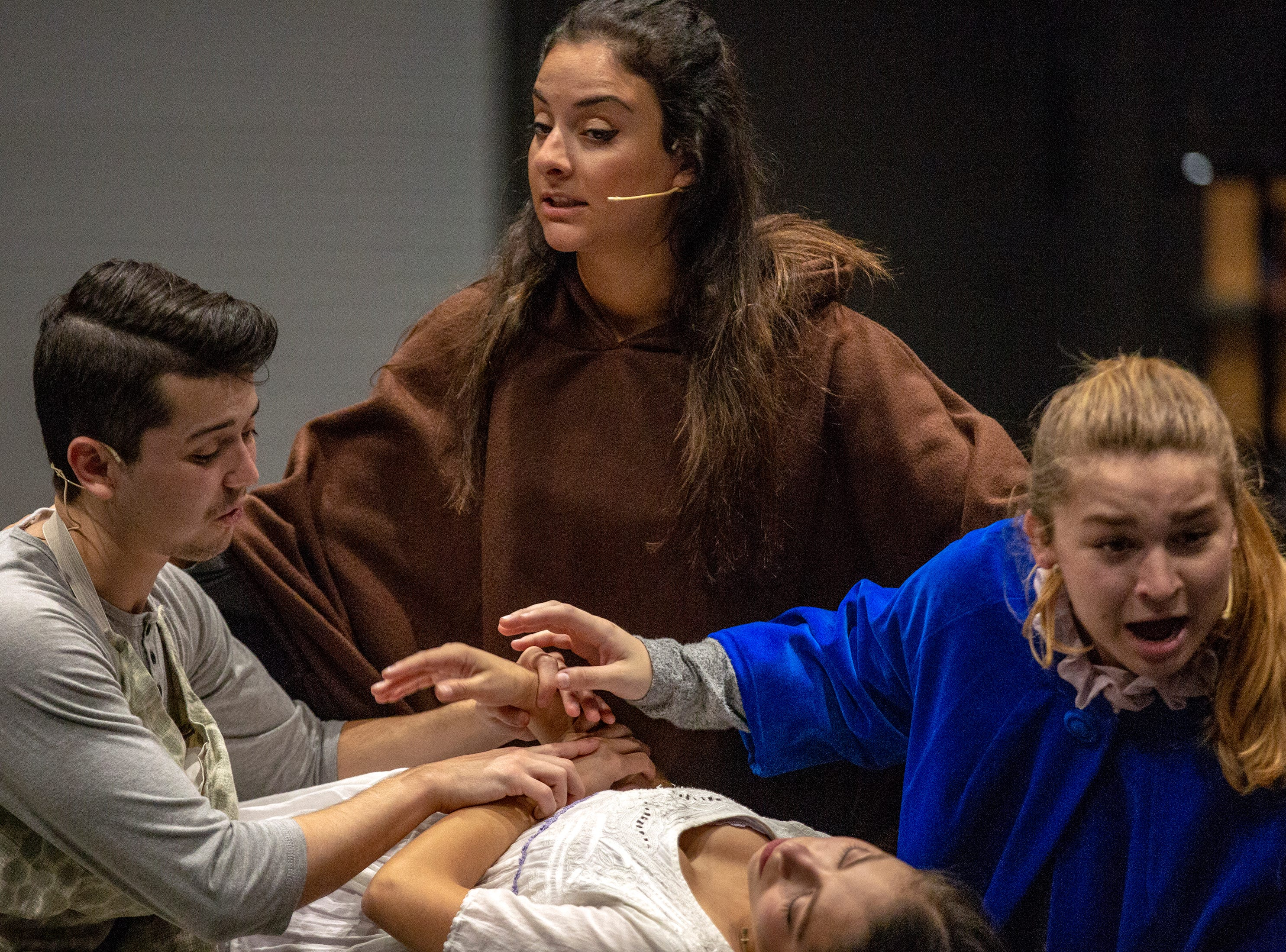 Florida Reparatory Theater actors, from clockwise left, Mikey Reicherl, Genevieve Tankosich, Tova Volcheck and Sydney Torres act in a scene from Romeo and Juliet Thursday, Feb. 28, 2019, at Bonita High School's black box theater.