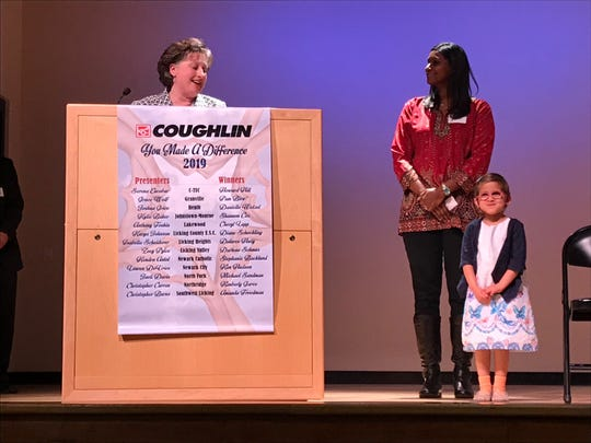 Licking County Educational Service Center pre-school teacher Diane Schockling talks about student Kavya Johnson and her mom, who nominated her for the 2019 You Made A Difference Award, during the ceremony Wednesday at C-TEC in Newark. Coughlin Automotive has sponsored the awards for 20 years.