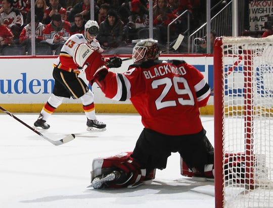 Mackenzie Blackwood (29) of the New Jersey Devils makes the first period save on Johnny Gaudreau #13 of the Calgary Flames at the Prudential Center on February 27, 2019 in Newark, New Jersey.