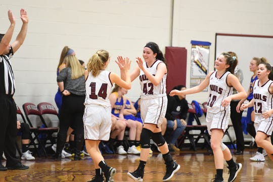 Butler at Park Ridge in a North 1, Group 1 girls basketball quarterfinal on Thursday, February 28, 2019. PR #42 Shannon Burns celebrates after making a shot at the end of the second quarter. (right) PR #10 Kerry Perez and #12 Ashley McManus.