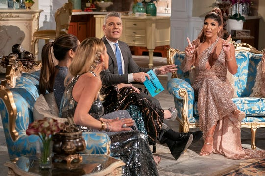 """Andy Cohen, and Teresa Giudice at """"The Real Housewives of New Jersey"""" reunion."""