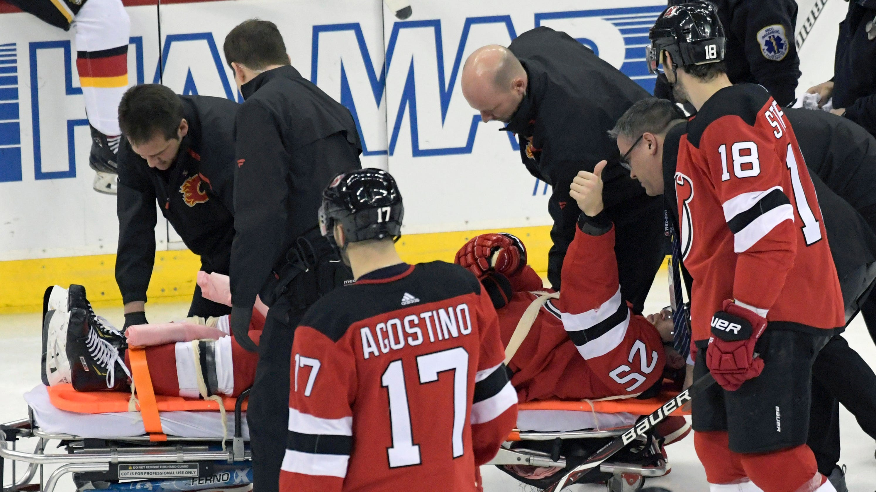 sports shoes f7d58 752ae NJ Devils' Mirco Mueller leaves game against Flames on stretcher