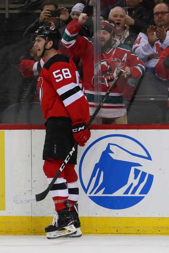 Feb 27, 2019; Newark, NJ, USA; New Jersey Devils center Kevin Rooney (58) celebrates after scoring a goal during the second period against the Calgary Flames at Prudential Center.