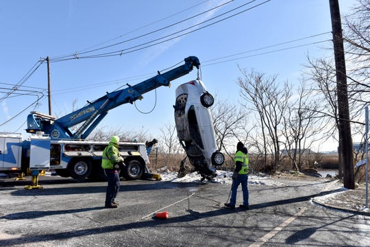 Emergency personnel are investigating a car that launched into Berry's Creek in the Meadowlands at the end of Union Ave in East Rutherford on Thursday February 28, 2019. Dive Teams from Lyndhurst and Wallington are assisting along with boats from Carlstadt.