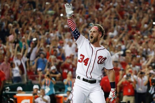 FILE - In this July 16, 2018, file photo, Washington Nationals Bryce Harper (34) reacts to his winning hit during the Major League Baseball Home Run Derby, in Washington. A person familiar with the negotiations tells The Associated Press that Bryce Harper and the Philadelphia Phillies have agreed to a $330 million, 13-year contract, the largest deal in baseball history. The person spoke to the AP on condition of anonymity Thursday, Feb. 28, 2019,  because the agreement is subject to a successful physical.