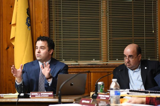 Daniel Steinhagen, Board Attorney, speaks during a Leonia Planning Board meeting on Wednesday, February 27, 2019. (right) Leonia Mayor Judah Zeigler. The borough is conducting a study about redevelopment and is considering using eminent domain.