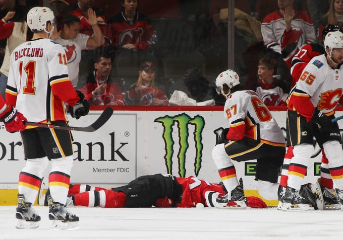 94efd5358 NJ Devils edged by Calgary Flames on night Mirco Mueller is carted off