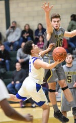 Brandon Licursi , right, and the West Milford boys basketball team faced Ramapo on Thursday night in the second round of the North 1 Group 3 playoffs.