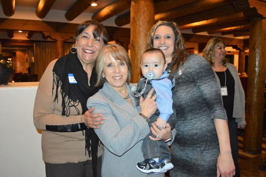 From left, HELP New Mexico Director Gloria Lopez, Governor Michelle Lujan Grisham, baby Martin Esparza and New Mexico Head Start Association Secretary Crystal Pena.