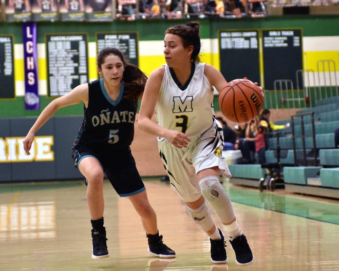 Mayfield's Alyssa Madrid looks over her shoulder and Oñate's Mary Limon closes in on defense during Wednesday's District 3-5A playoff game held at Mayfield High School.
