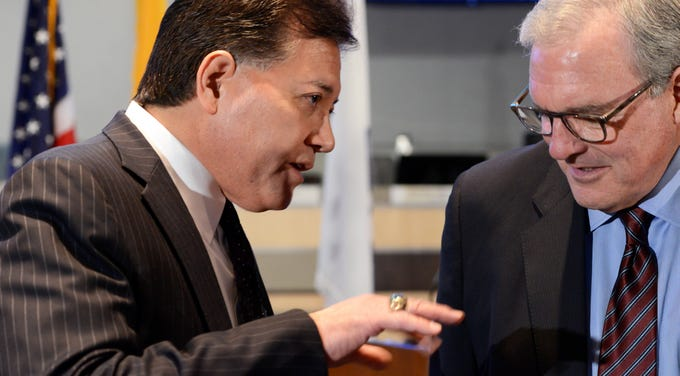 "Mayor Ken Miyagishima, left, speaks to El Paso Mayor Dee Margo before his ""State of the City"" address on Thursday, Feb. 28, 2019."