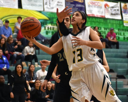 Mayfield's Raena Tesillo gets fouled by Oñate's Estrella Avalos as she goes in for a lay up during Wednesday night's district playoff game.
