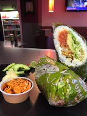 Sushi Freak menu items include sushi burritos that customers create on their own.