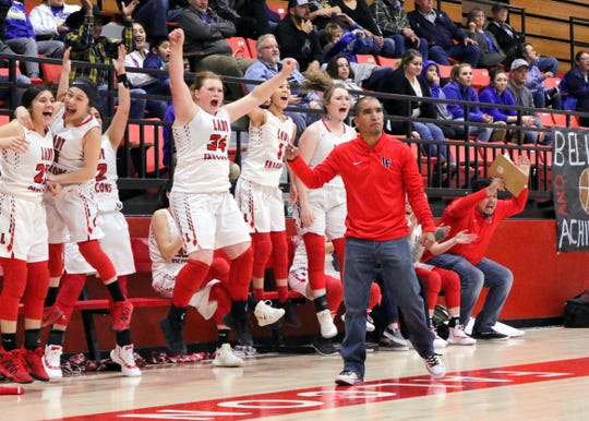 The Loving Lady Falcons bench reacts to a last-second shot in the district tournament in 2019 which sent the team to the championship game. Loving will be making its second straight NMAA state basketball tournament appearance on Friday, heading to Penasco to face the No. 1 Lady Panthers.