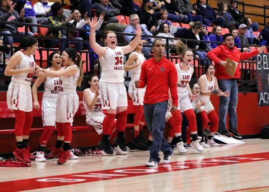 Loving girls head coach Derrick Martinez and his bench react to a last-second made basket against Jal on Feb. 19. The two teams meet up again on Saturday for the fifth time this season.