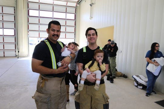 Sam Soto (left) and son Samuel Soto and Brad Wootton with son Kennedy.