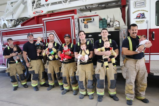 Carlsbad firefighters gather with their babies at Fire Station No. 7 at 304 W. Wood.