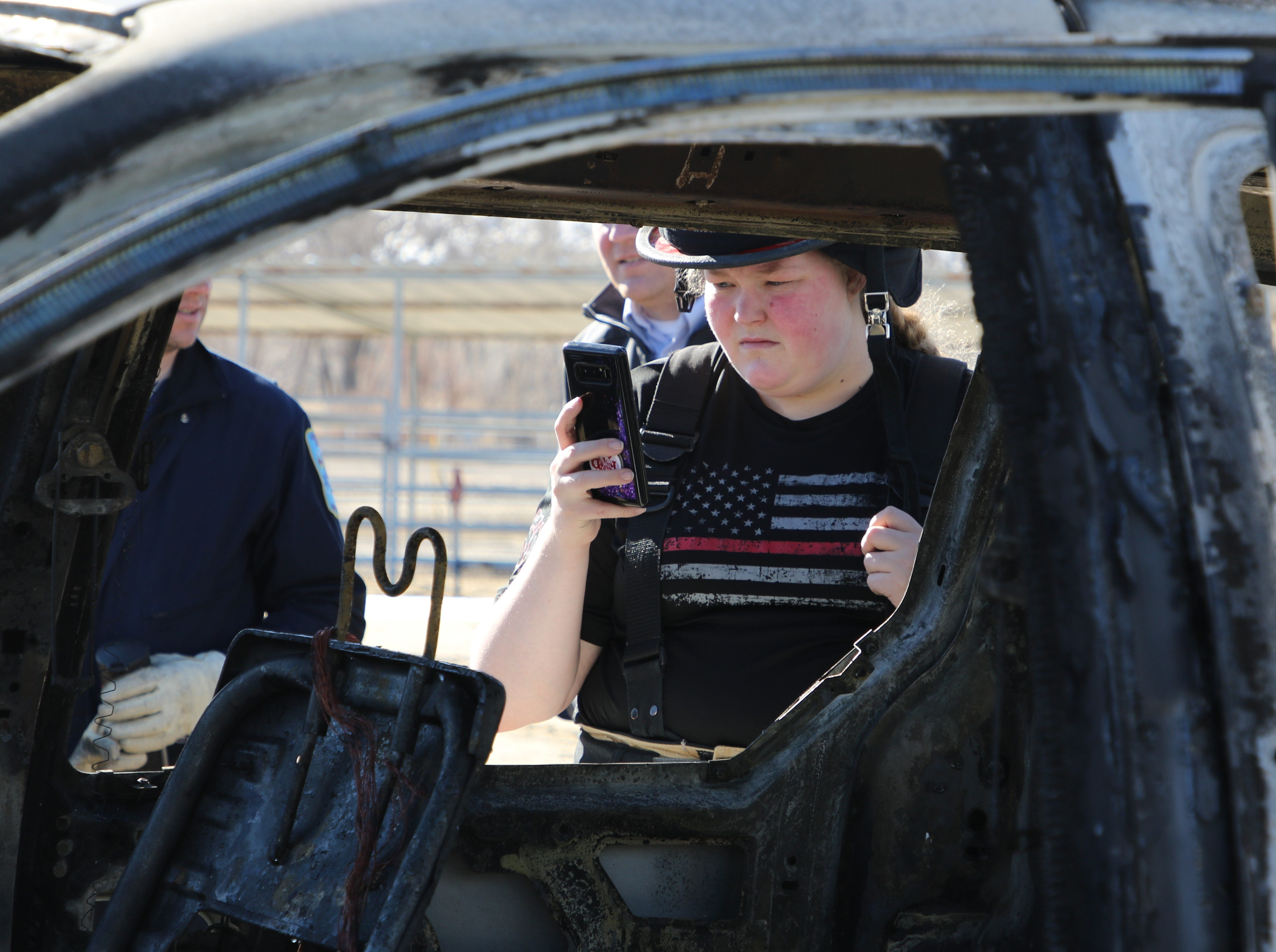 San Juan County Fire Department volunteer firefighter Caitlyn Vecellio records information during a training session at McGee Park on Wednesday.
