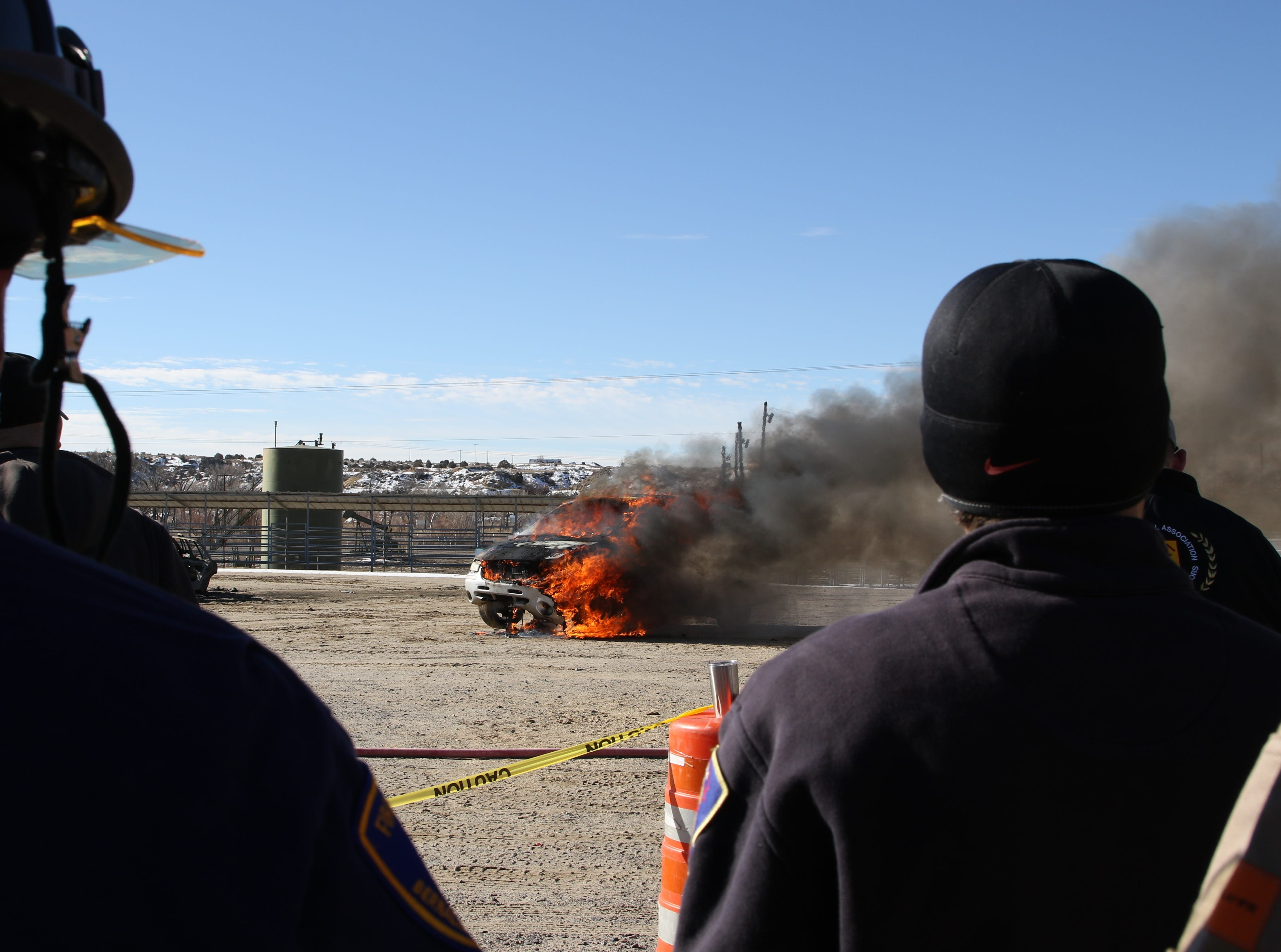 Fire investigators observe a mock auto fire as part of training on Wednesday by the International Association of Arson Investigators.