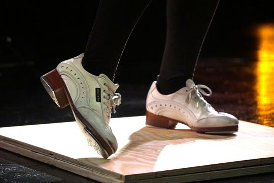 Kelsey Rose's tap shoes move quickly on an inch-thick oak board on Feb. 28. Young needs to tap dance on the added wood boards or her metal-plated tap shoes would ruin floor surfaces.