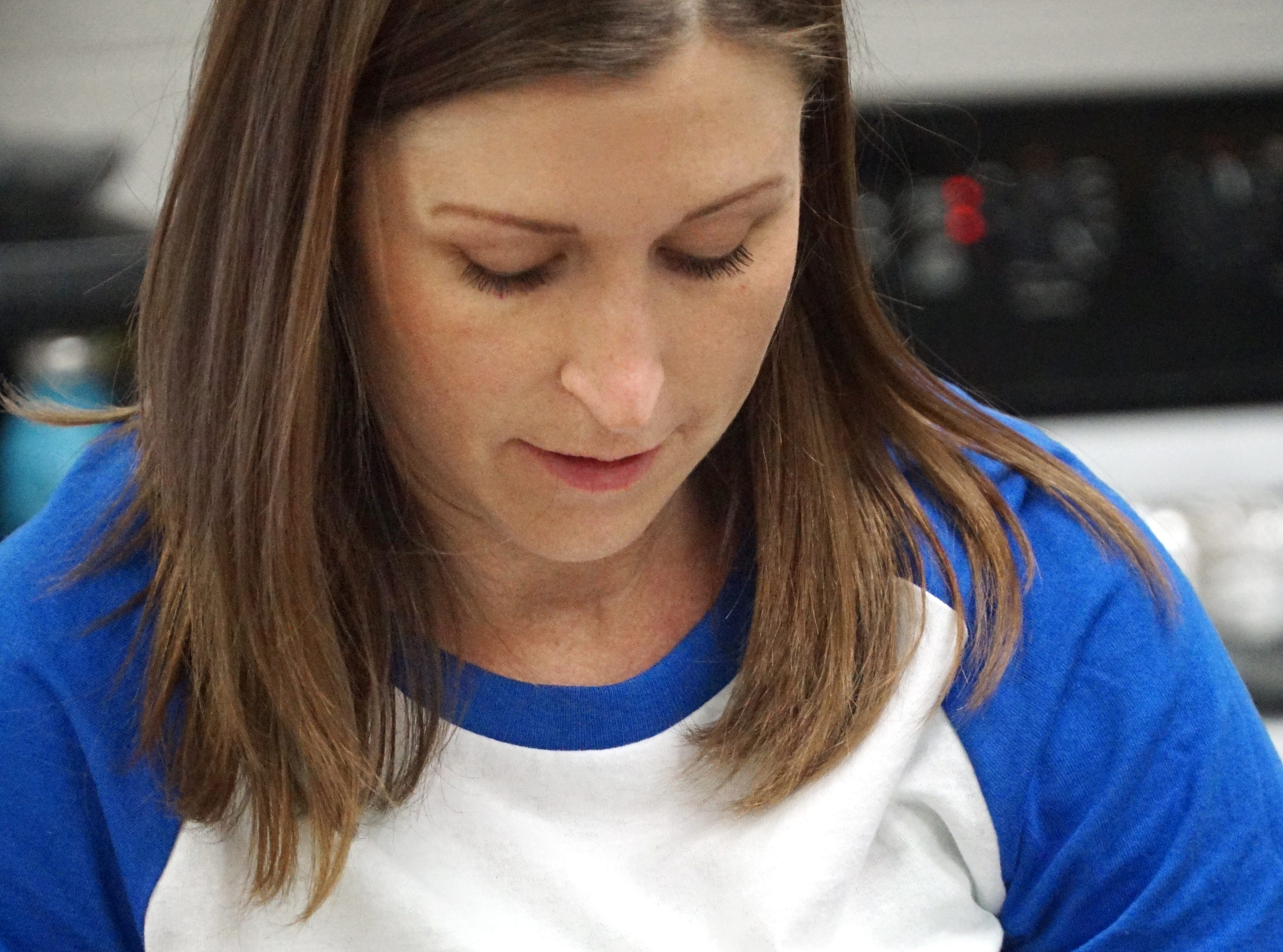 Teacher Briona McKinney wears a shirt that shows Harlan Elementary's baking program for its kids on the autism spectrum.