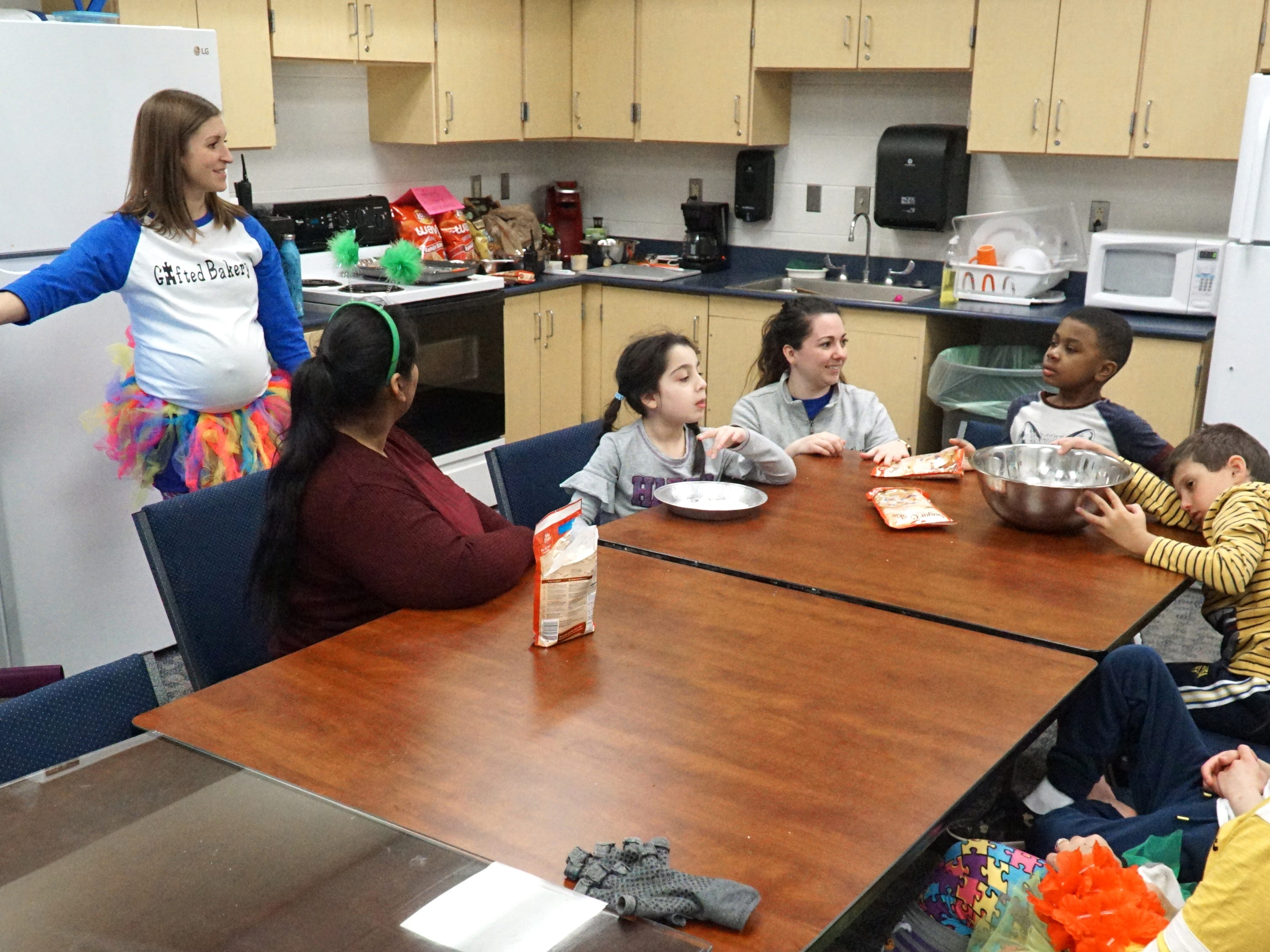 The Gifted Bakery program at Birmingham's Harlan Elementary prepares to make some chocolate and toffee chip cookies at the school on Feb. 28. From left are teachers Briona McKinney and Irna Singh, and student Grace Karim, teacher Victoria LaBush, and students Payce Jenkins and Christian Vuljaj.