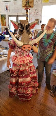 Individuals at one of the Mardi Gras mask-making workshops held at the NUNU's in Arnaudville, displays the Martinique-inspired costumes designed there last weekend.
