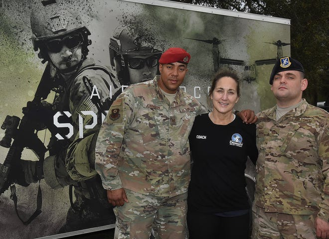 U.S. Air Force Special Forces sergeants William Johnson and Don Stoelting, pose with CrossFit operator Bambi Panagiotis on Wednesday during their stopover in Opelousas. Johnson, Stoelting are accompanying 12 Air Force Special Forces volunteers who are performing an 830-mile commemorative walk than began in San Antonio on Feb. 22 to honor the deaths of tactical unit members who have been killed in action.