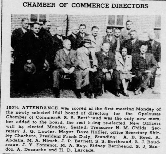 1941 Association of Commerce Board of Directors. J. G. Lawler is pictured as the secretary in the photo.